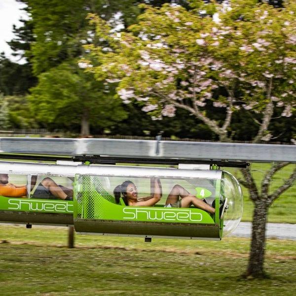 Kids racing on Velocity Valley Shweeb racer in Rotorua